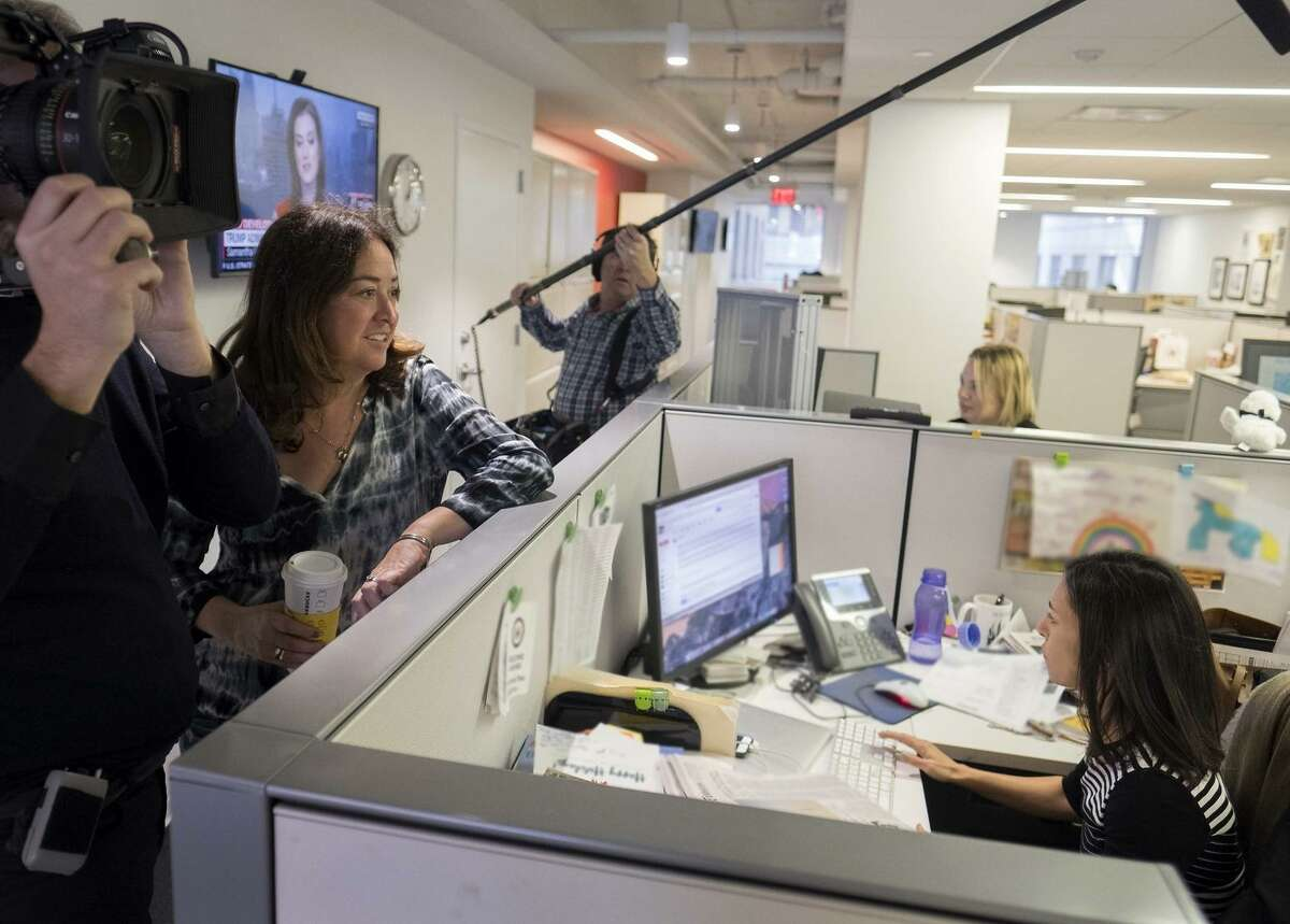 Director Liz Garbus (with cup) spent countless hours in the New York Times newsroom for her new film.