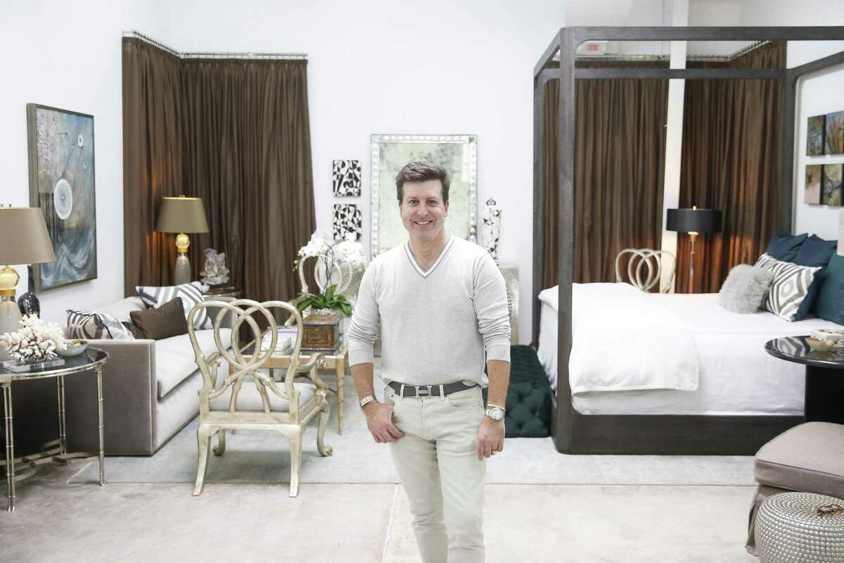 Meet Denny Lyons: Denny Lyons of Dennis Lyons Interiors created a contemporary master bedroom suite for the gray tuxedo sofa he designed himself. He used art from Ellen H. Ray and Tanna Bennett of The Silos.