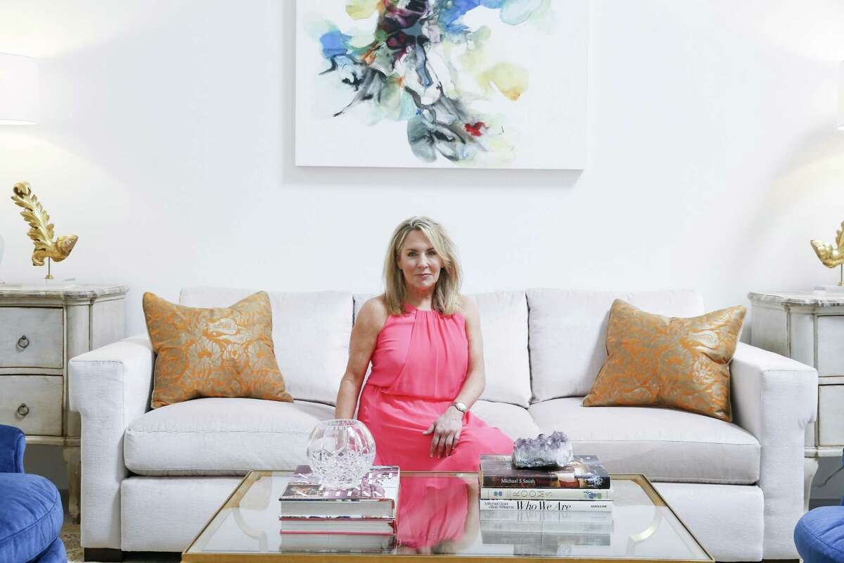 Meet Cheryl Baker: Cheryl Baker of CDB Interiors used a light gray sofa with pops of blue and tan in a light, comfortable space. Her sofa was from Lam Bespoke; she used art by Cookie Ashton and Marthann Masterson of The Silos.