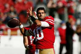 SANTA CLARA, CA - NOVEMBER 05: Jimmy Garoppolo #10 of the San Francisco 49ers warms up before the game against the Arizona Cardinals at Levi's Stadium on November 5, 2017 in Santa Clara, California. (Photo by Lachlan Cunningham/Getty Images)