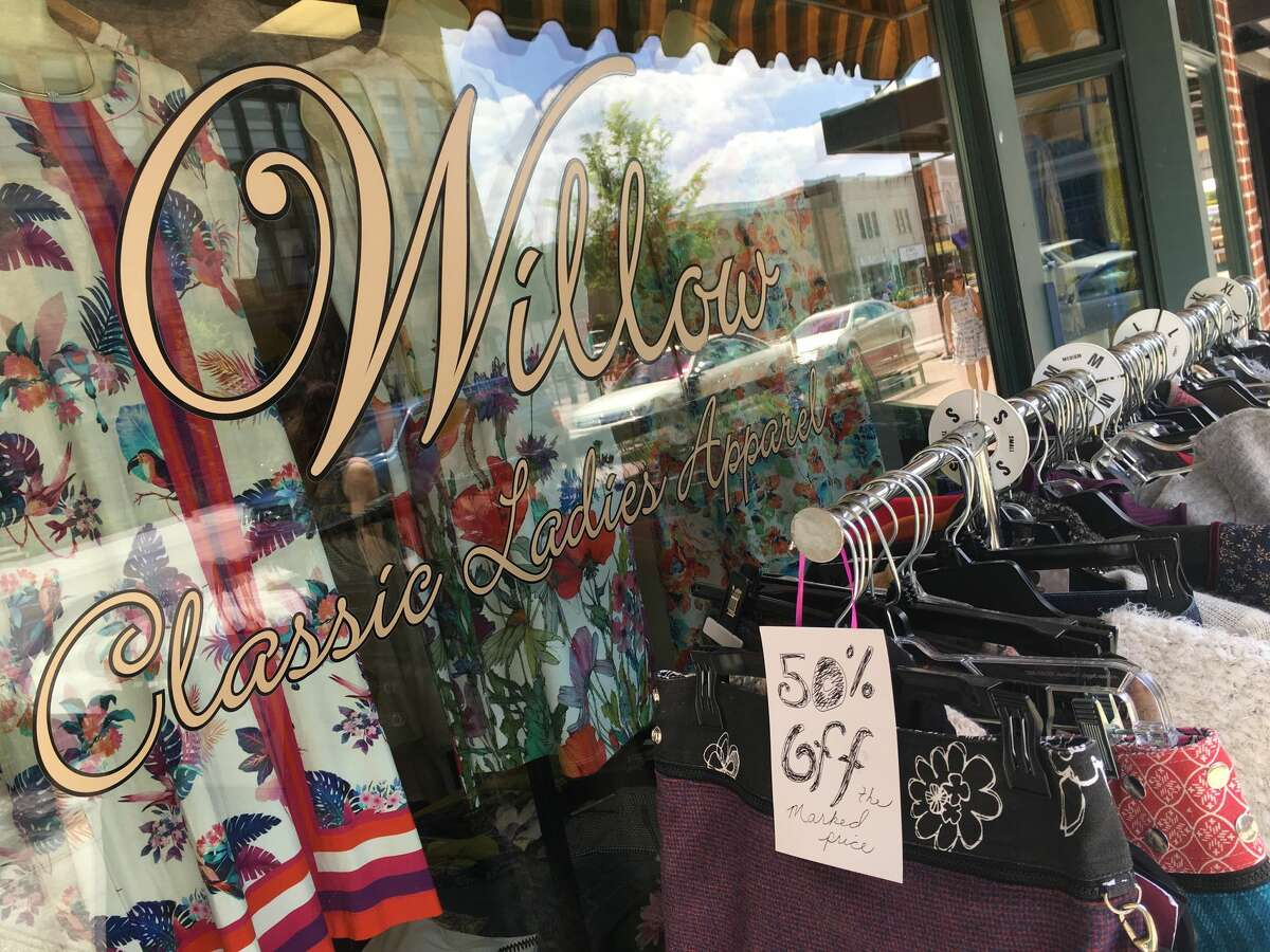 Items on sale are available in front of Willow Classic Ladies Apparel during a sidewalk sale in downtown Midland on Thursday, July 19, 2018. (Katy Kildee/kkildee@mdn.net)