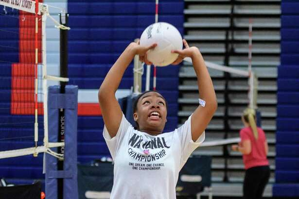 Jordan Eager, 13, sets the ball during the Clear Lake volleyball camp at Krueger Field House. (Photos by ©Kim Christensen)