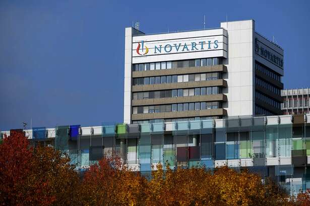 (FILES) This file photograph taken on October 27, 2015, shows the logo of Swiss pharmaceutical giant Novartis on the top of a building at the company's campus in Basel. The Swiss pharmaceutical giant Novartis saw its net profit jump to USD 9.7 billion (Euro 8.4 billion), boosted by the sale of its non-prescription drug business to Britain's GlaxoSmithKline (GSK), does it announced July 18. 2018. / AFP PHOTO / Fabrice COFFRINIFABRICE COFFRINI/AFP/Getty Images