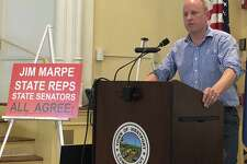 Rober Harrington, a member of Smart Water Westport, spoke at the July 12 Public Utilities Regulatory Authority (PURA) public comment session in Westport Town Hall in opposition to Aquarion Water Company's current plans for the construction of two water storage tanks on North Avenue.