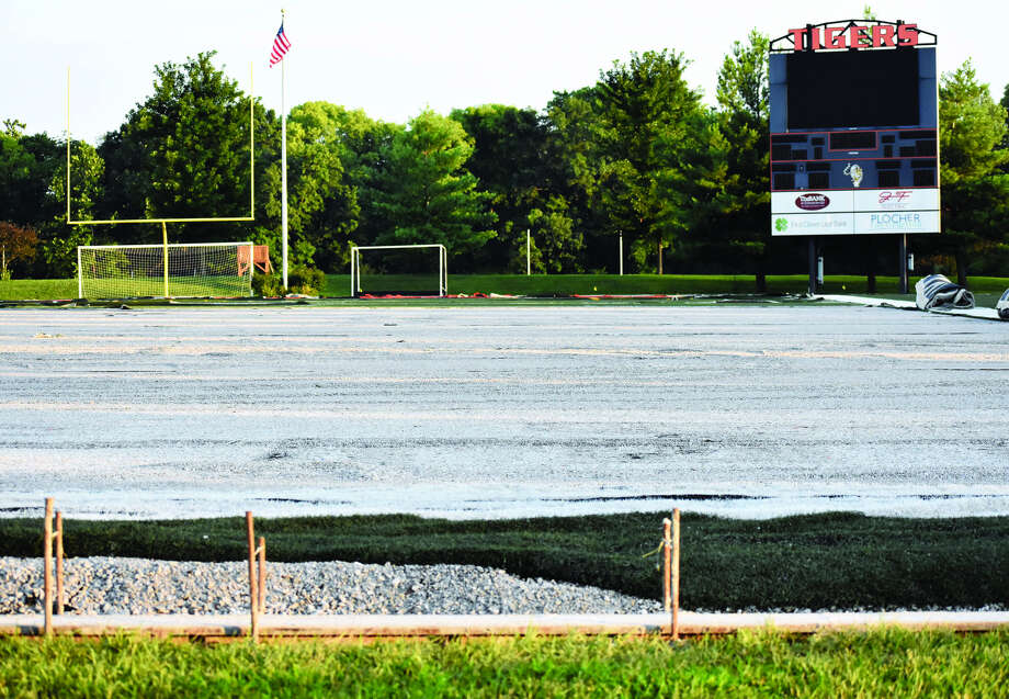 In this photo from Saturday evening, the turf at the District 7 Sports Complex is being replaced before the start of the next academic year. Photo: Matthew Kamp
