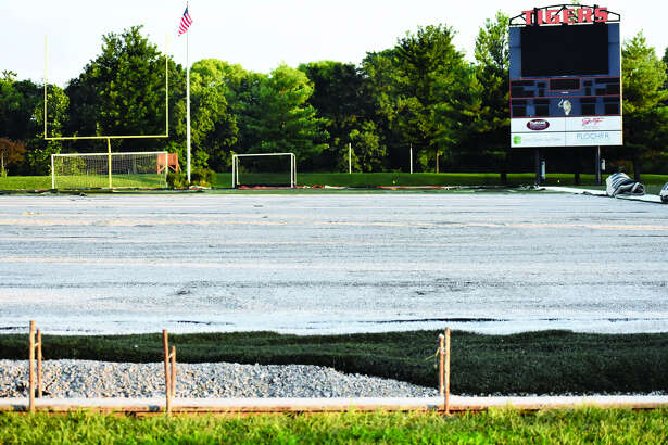 In this photo from Saturday evening, the turf at the District 7 Sports Complex is being replaced before the start of the next academic year.