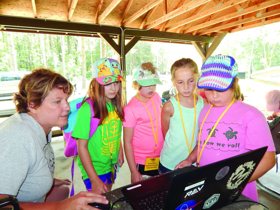 Girl Scouts learn about programming robots at GSSI's recent Mini STEM Day Camp. Photo: For The Intelligencer