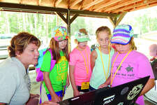 Girl Scouts learn about programming robots at GSSI's recent Mini STEM Day Camp.