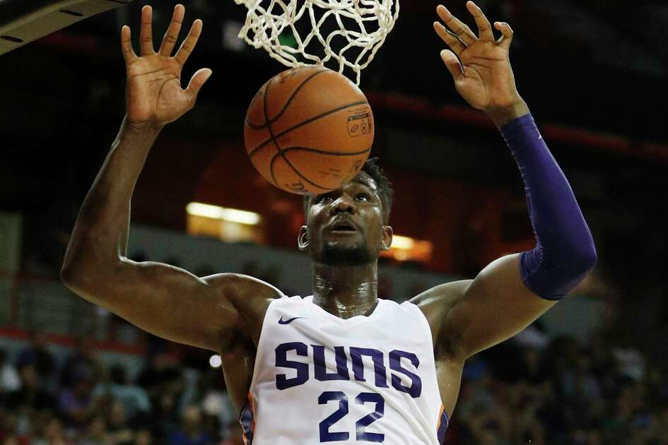 Phoenix Suns' Deandre Ayton dunks against the Dallas Mavericks during the second half of an NBA summer league basketball game Friday, July 6, 2018, in Las Vegas. (AP Photo/John Locher)