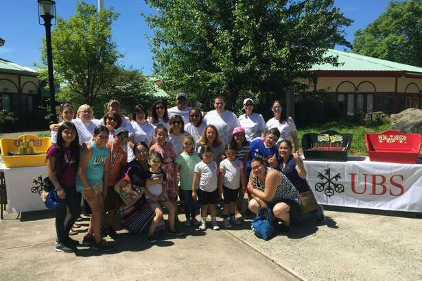 UBS Westport employees participated in the Season of Service activities with Bridgeport-area families at the Wing Ding parade in June.