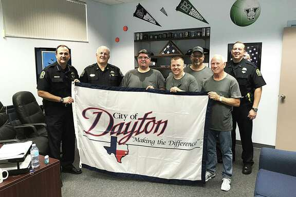 City Manager Theo Melancon, center, with other city leaders presented a city of Dayton flag to Venice, Florida, on their humanitarian trip following Harvey. Venice had just been hit by Hurricane Irma and the Dayton contingent took supplies to help them and pay it forward.