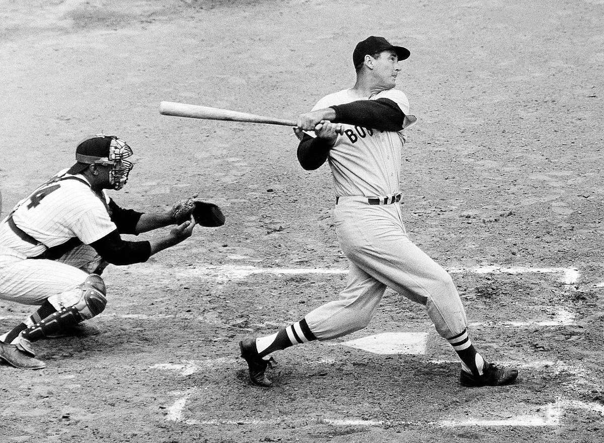 Ted Williams knocks the ball out of the park against the Senators.