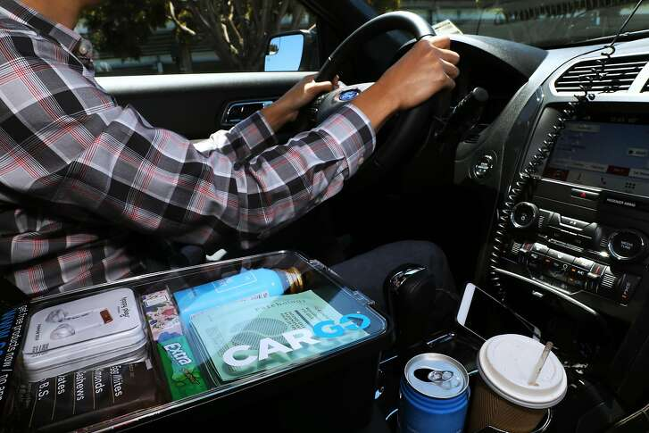 Kenny Liao, head of driver supply growth and operations, Cargo, drives around the city with a Cargo box in San Francisco, Cali. on Tuesday, July 17, 2018. San Francisco Uber cars soon will have minibar-like boxes filled with snacks, drinks and sundries for sale. New York's Cargo, which makes the box, is launching in SF and partnering with Uber.