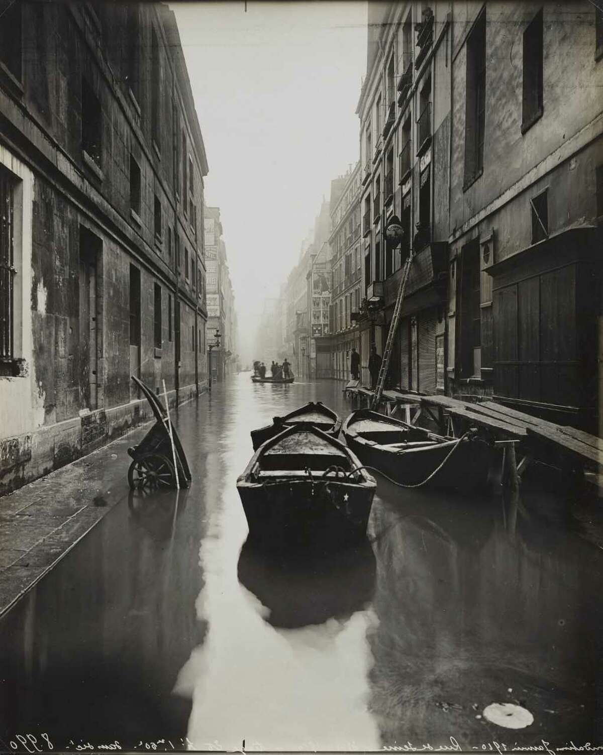 """Unknown """"Paris Flood - 1910 Street with Boats and Cart."""" Gelatin silver print"""