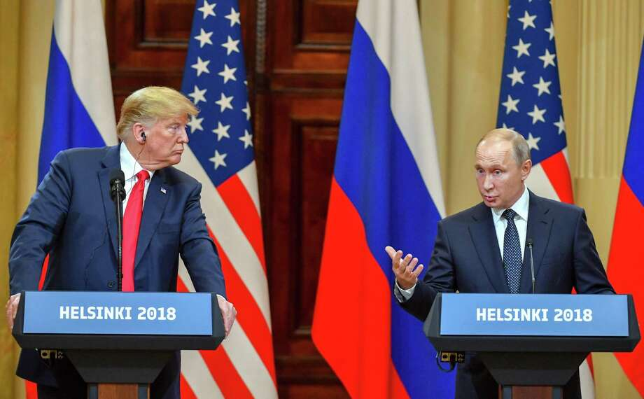 US President Donald Trump, left, listens as Russia's President Vladimir Putin speaks during a joint press conference after a meeting at the Presidential Palace in Helsinki, on Monday. Trump refused to push Putin on Russian interference in U.S. elections. Photo: YURI KADOBNOV /AFP /Getty Images / ONLINE_YES