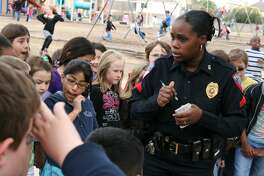 "Humble ISD Police Corporal Journet talks and ""questions"" students about the mysterious eggs and what they think could have liad them at the school as a part of the Timbers Elementary Everybody Writes Day Feb. 19."
