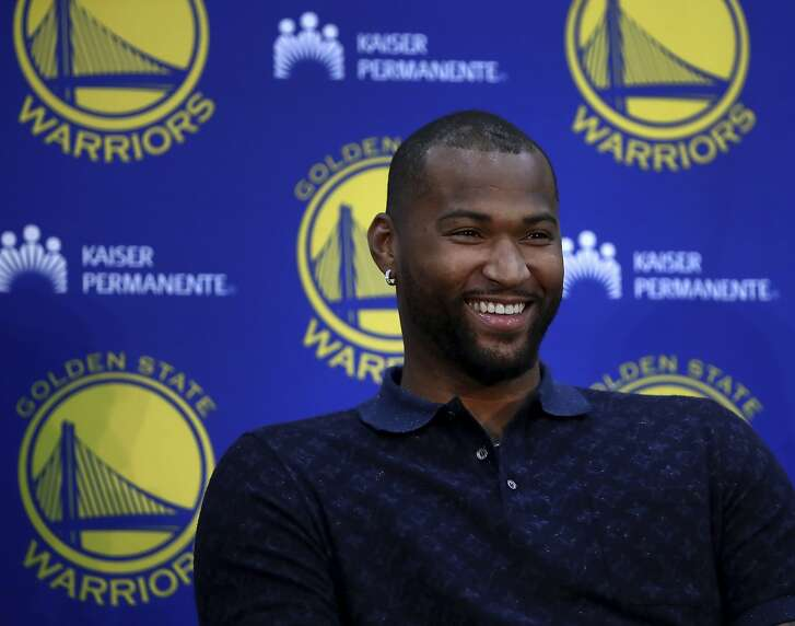 Golden State Warriors' DeMarcus Cousins smiles during a media conference Thursday, July 19, 2018, in Oakland, Calif. Cousins signed a one-year, $5.3M deal with the defending champion Warriors. (AP Photo/Ben Margot)