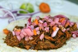 Cochinita pibil Yucatan-style tacos from Chela's Tacos.