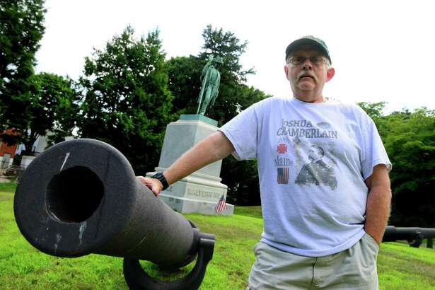 "George Geer, who is Commander of the Wooster-Russell Camp 22 of the Sons of the Union Veterans, poses at the Civil War Memorial at Pine Grove Cemetery in Ansonia, Conn., on Friday July 13, 2018. The monument, which features four Parrott rifles around it, reads: ""Ansonia's Tribute to the Memory of Her Sons Who Gave Their Lives To Their County in the Rebellion of 1861-1865."" Underneath are the names of four battles: Malvern Hill, Antietam, Mobile and Gettysburg."