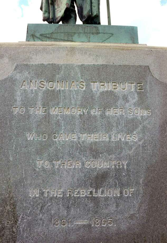 """A view of the Civil War Memorial at Pine Grove Cemetery in Ansonia, Conn., on Friday July 13, 2018. The monument, which features four Parrott rifles around it, reads: """"Ansonia's Tribute to the Memory of Her Sons Who Gave Their Lives To Their County in the Rebellion of 1861-1865."""" Underneath are the names of four battles: Malvern Hill, Antietam, Mobile and Gettysburg. Photo: Christian Abraham / Hearst Connecticut Media / Connecticut Post"""