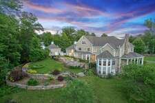 """Former IBM Vice President John Patrick's Whipstick Road home in Ridgefield will be auctioned off by Platinum Luxury Auctions on July 28. Designed by MacMillan Architects in collaboration with Phoenix Audio Video of Fairfield, the """"smart house"""" features fully-integrated home automation."""