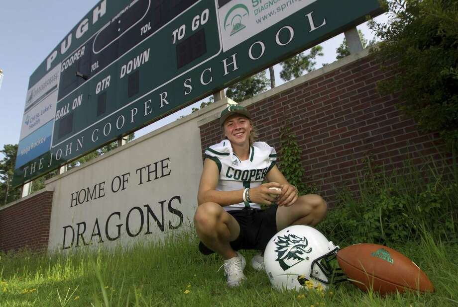 John Cooper dual-sport athlete Evan Minarovic poses for a portrait at Pugh Field on Tuesday, July 18, 2018, in The Woodlands. Minarovic is the starting quarterback for the Dragons in the fall and a shortstop and pitcher for the baseball team in the spring. Photo: Jason Fochtman, Staff Photographer / Houston Chronicle / © 2018 Houston Chronicle