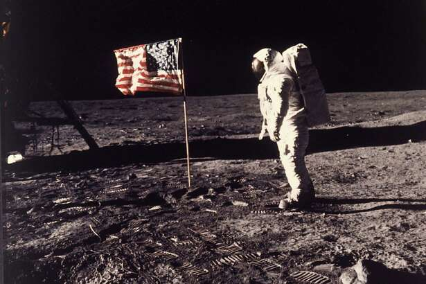 In this July 20, 1969 photo, Astronaut Buzz Aldrin poses for a photograph beside the U.S. flag deployed on the moon during the Apollo 11 mission. The photo was taken by astronaut Neil Armstrong.