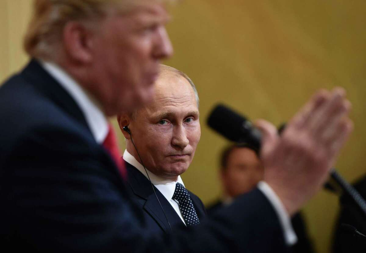 President Donald Trump and Russia's President Vladimir Putin attend a joint press conference after a meeting at the Presidential Palace in Helsinki, on July 16, 2018.
