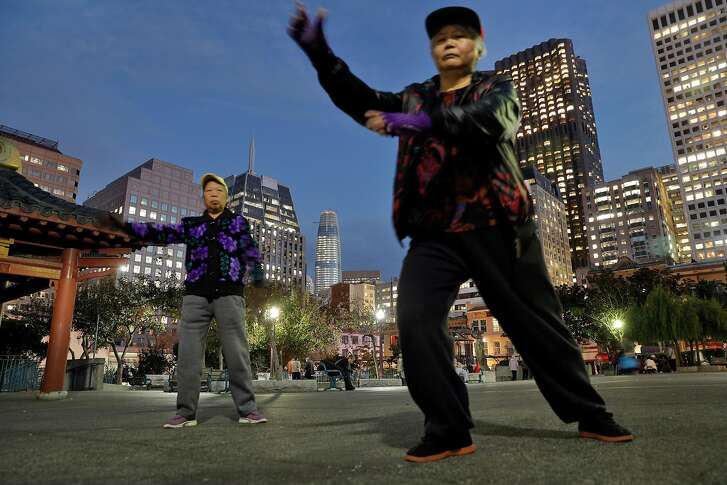 Residents of Chinatown practice Tai Chi in Portsmouth Square Park with the Salesforce Tower in the background in San Francisco, Calif., Thursday, November 2, 2017.