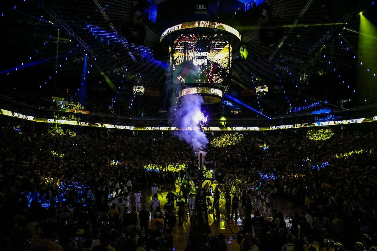 Oracle Arena is lit up at the start of Game 1 of the The NBA Finals between the Golden State Warriors and the Cleveland Cavaliers in Oakland, California, on Thursday, May 31, 2018.