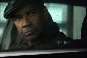 """This image released by Columbia Pictures shows Denzel Washington in a scene from """"Equalizer 2."""" (Sony, Columbia Pictures via AP)"""