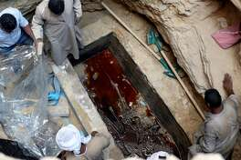 Archaeologists in Egypt pried open a mysterious, 2,000-year-old sarcophagus found in the port city of Alexandria earlier this month.