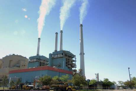 FILE - In this July 1, 2013, file photo, smoke rises from the Colstrip Steam Electric Station, a coal burning power plant in Colstrip, Mont. The Trump administration is advancing its plan to replace the centerpiece of President Barack Obama's efforts against global warming with a new rule expected to be more friendly to the coal industry. (AP Photo/Matthew Brown, File)