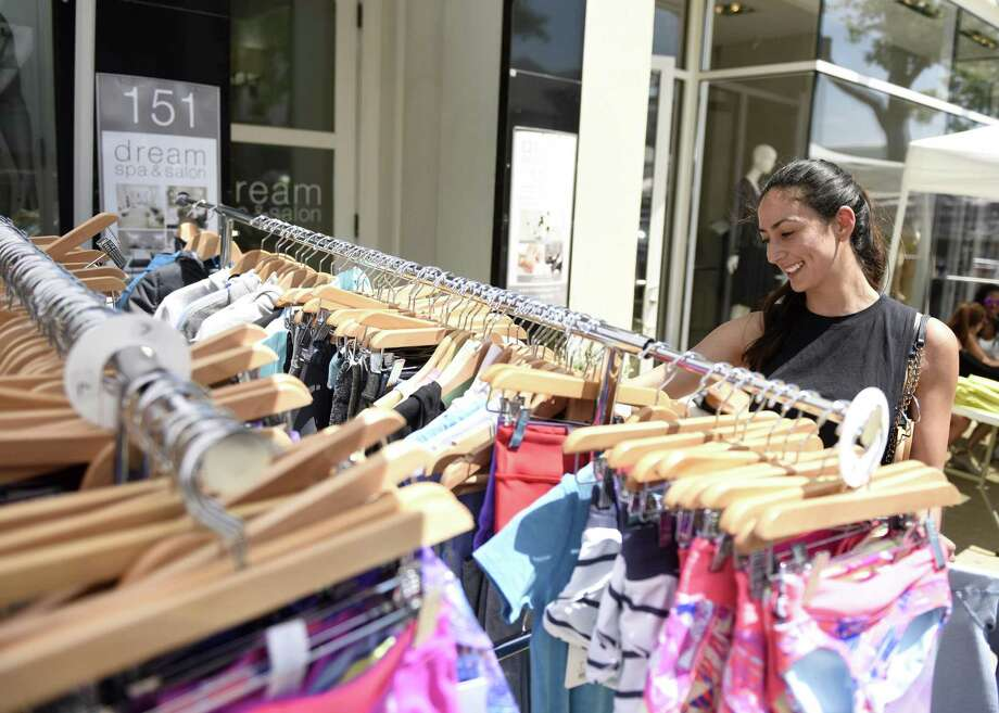 Greenwich's Daisy McRandal shops sale items at Lululemon at the 2018 Sidewalk Sale Days. Photo: Tyler Sizemore / Hearst Connecticut Media / Greenwich Time