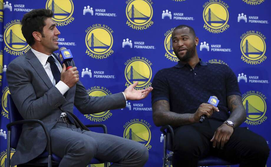 Warriors general manager Bob Myers, left, helps introduce his new center, DeMarcus Cousins, to the media Thursday. Photo: Ben Margot / Associated Press