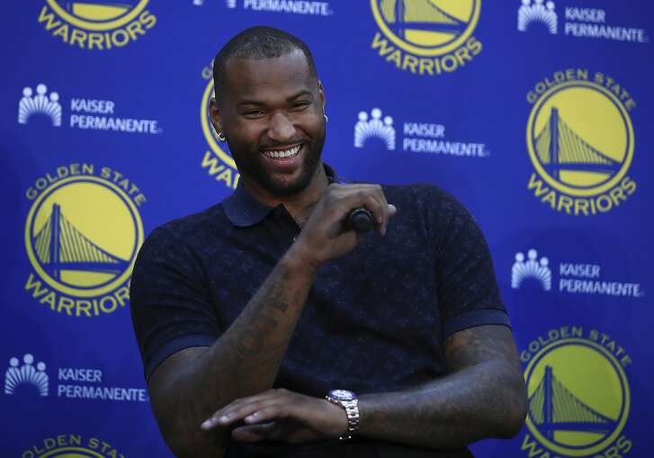 Golden State Warriors' DeMarcus Cousins laughs during a media conference Thursday, July 19, 2018, in Oakland, Calif. Cousins signed a one-year, $5.3M deal with the defending champion Warriors. (AP Photo/Ben Margot)