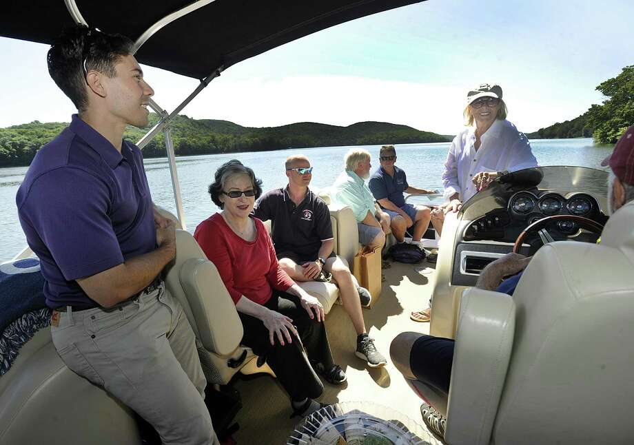 Among those taking a tour of Candlewood Lake Thursday, July 19, 2018, are from left, State rep. David Arconti, Phyllis Schaer, chairman of the Candlewood Lake Authority, Mark Howarth, executive director, State Sen. Craig Minora,  Larry Marscicano, limnologist and former executive director of the CLA and Connie Trolle, president of Connecticut federation of lakes and Bantam Lake protective association. Photo: Carol Kaliff / Hearst Connecticut Media / The News-Times