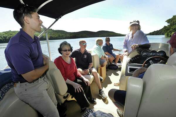 Among those taking a tour of Candlewood Lake Thursday, July 19, 2018, are from left, State rep. David Arconti, Phyllis Schaer, chairman of the Candlewood Lake Authority, Mark Howarth, executive director, State Sen. Craig Minora,  Larry Marscicano, limnologist and former executive director of the CLA and Connie Trolle, president of Connecticut federation of lakes and Bantam Lake protective association.