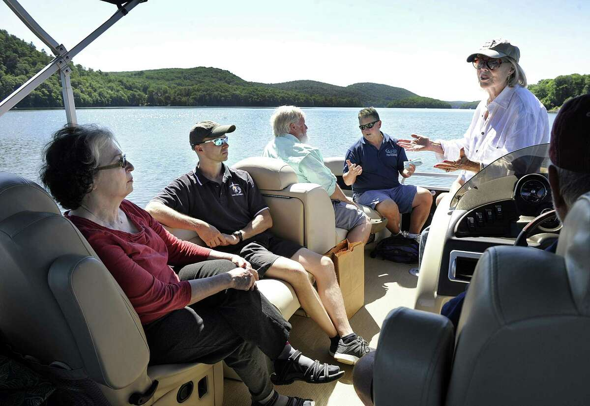 Among those taking a tour of Candlewood Lake Thursday, July 19, 2018, are from left, Phyllis Schaer, chairman of the Candlewood Lake Authority, Mark Howarth, executive director, State Sen. Craig Minora, Larry Marscicano, limnologist and former executive director of the CLA and Connie Trolle, president of Connecticut federation of lakes and Bantam Lake protective association.