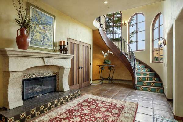 Colorful tiles surround the foyer's raised fireplace at 1677 Lucas Valley Road in San Rafael.