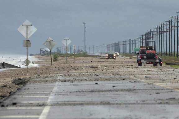 Debris covers Texas 87 as a result of Tropical Storm Cindy on June 22, 2017, in Bolivar Peninsula.