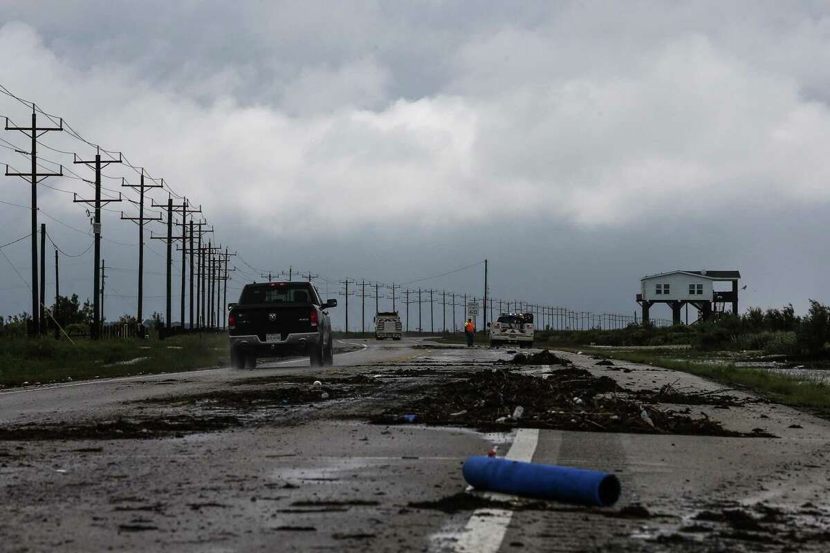 Debris sits on Texas 87 after Tropical Storm Cindy made landfall on June 22, 2017 on the Bolivar Peninsula.