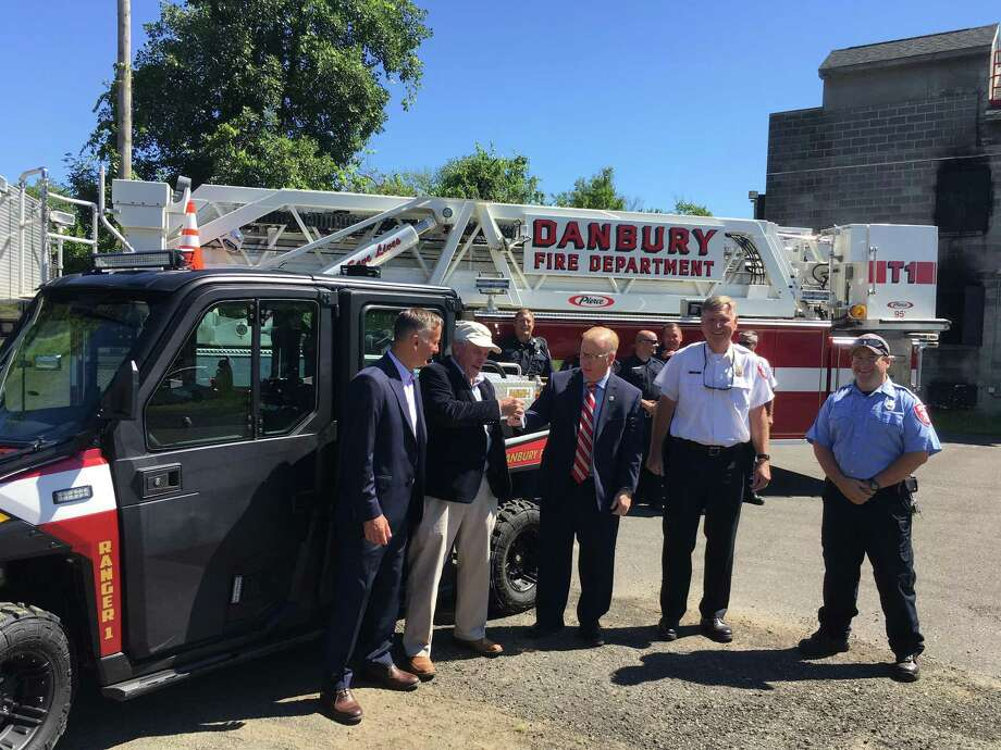 Enbridge manager Ed Harney, center left, gives the keys to Mayor Mark Boughton for a new Polaris Ranger the company donated to the fire department. Photo: / Dirk Perrefort