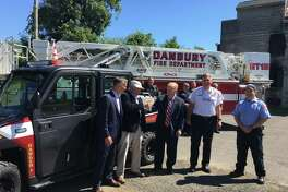 Enbridge manager Ed Harney, center left, gives the keys to Mayor Mark Boughton for a new Polaris Ranger the company donated to the fire department.