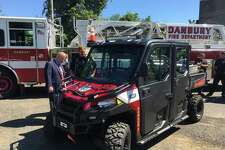 Danbury Mayor Mark Boughton and local firefighters check out a new Polaris Ranger that was donated to the city recently by Enbridge.