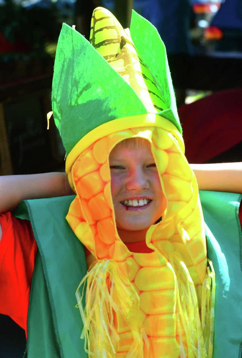 Robert Hurlock, 11, is dressed up as an ear of corn during the Walnut Beach Farmers Market at the Walnut Beach Pavilion in Milford, Conn., on Thursday, July 19, 2018. The market, sponsored by the Walnut Beach Arts and Business Association (WABABA) is held every third Thursday until October from 4 p.m. to 7 p.m.