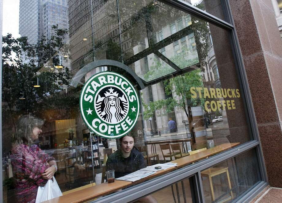 A Harvard Business School study found the arrival of Starbucks and other coffee shops to a neighborhood predicts a 0.5 percent increase in housing prices that year.  Photo: Elise Amendola, AP