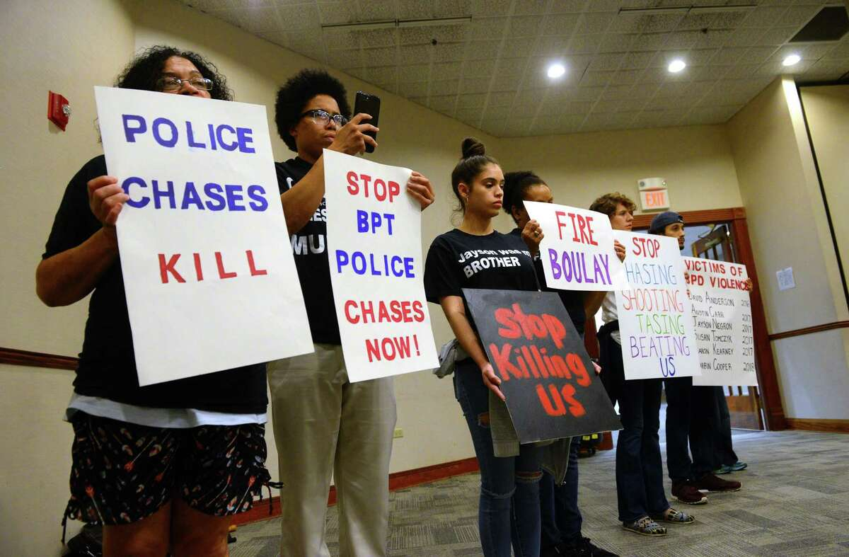 The Justice for Jayson Coalition protests during the Bridgeport Police Commission meeting at the Margaret Morton Government Center in Bridgeport, Conn., on Tuesday July 17, 2018. Jayson Negron, 15, was shot and killed by police in May of 2017.
