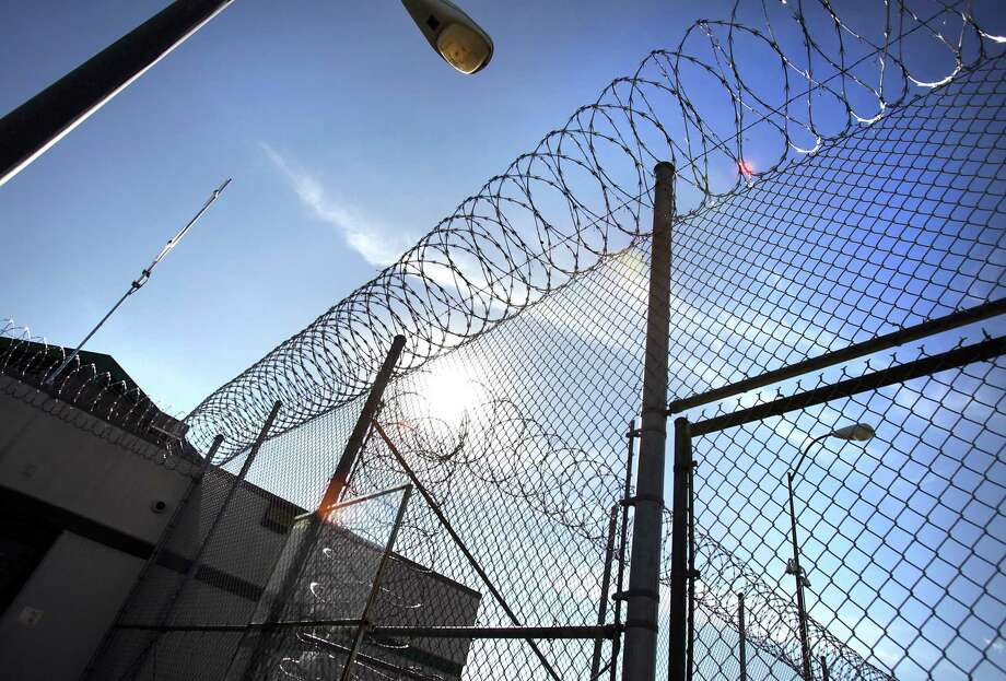 Razor wire on the fencing at the Polunsky Unit in Livingston, TX. Thursday, Jan. 5, 2012. Photo: BOB OWEN, STAFF / SAN ANTONIO EXPRESS-NEWS / rowen@express-news.net