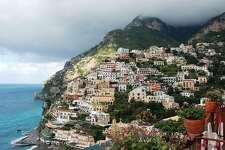Positano, the jewel of Italy s Amalfi Coast, hugs the rugged shoreline. Credit: Rick Steves